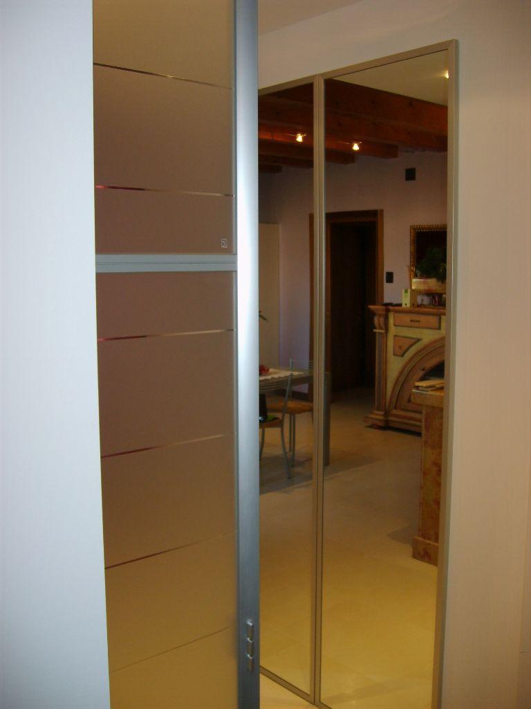 Porta scorrevole in cristallo per casa infix - Porta a specchio ...