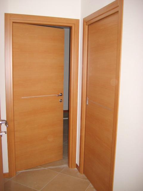 Porte interne in laminato noce tanganica infix - Porte noce chiaro ...