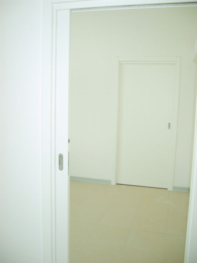 Porte interne in laminatino bianco infix - Porte interne scorrevoli ...