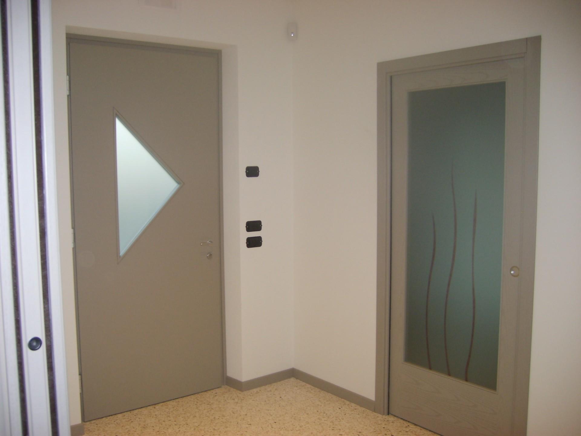 Porta entrata in legno infix for Infix serramenti e porte