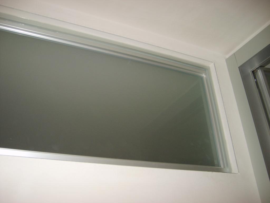 Porta scorrevole in cristallo per casa infix - Sopraluce porta ...